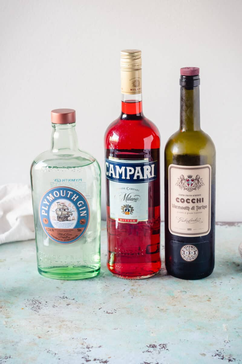 Bottles of Plymouth Gin, Campari, and Cocchi di Torino Sweet Vermouth