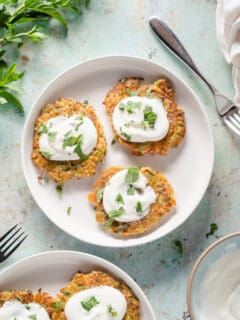 Zucchini fritters with yogurt and mint on a plate