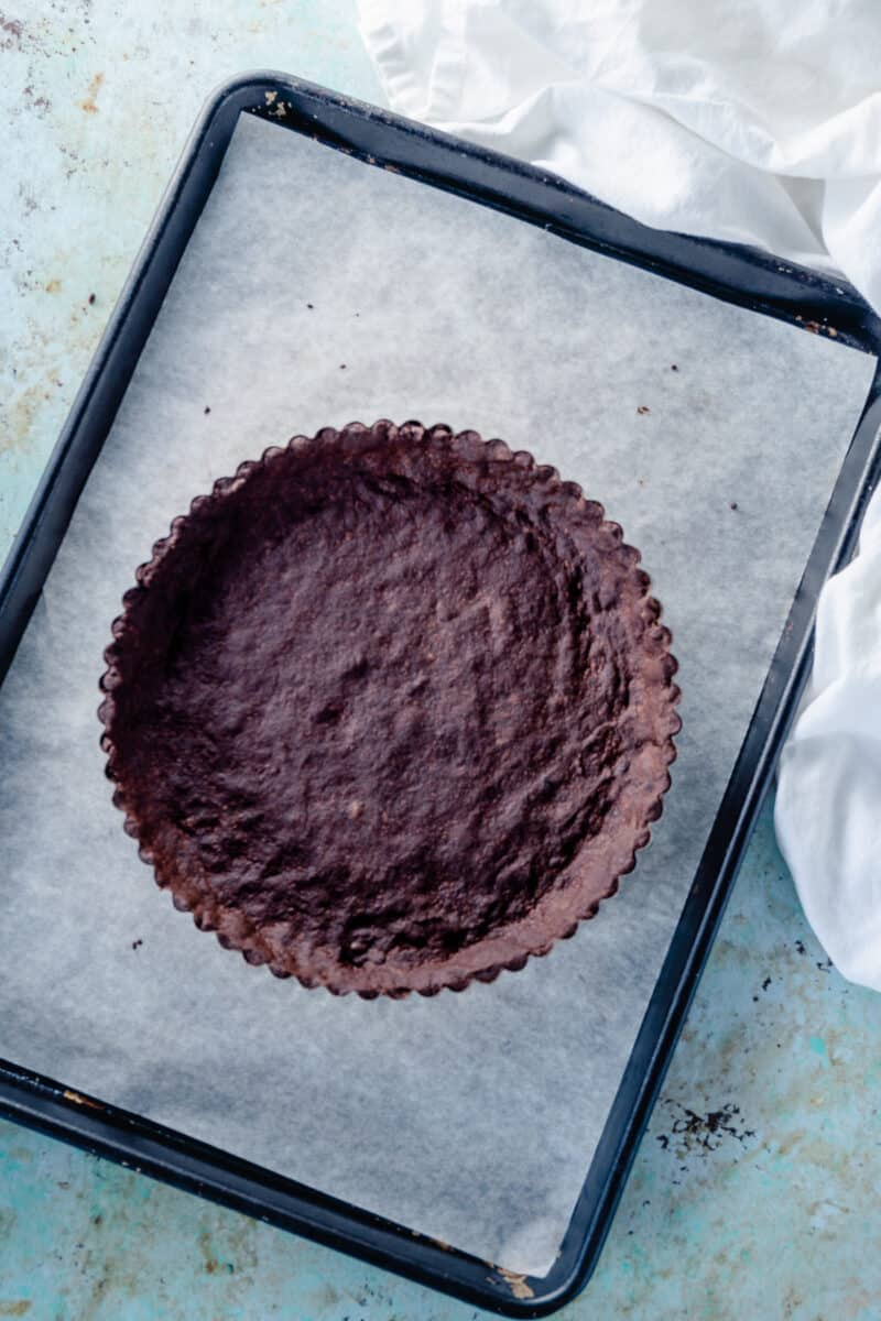 Chocolate Shortbread Tart Crust on a baking sheet