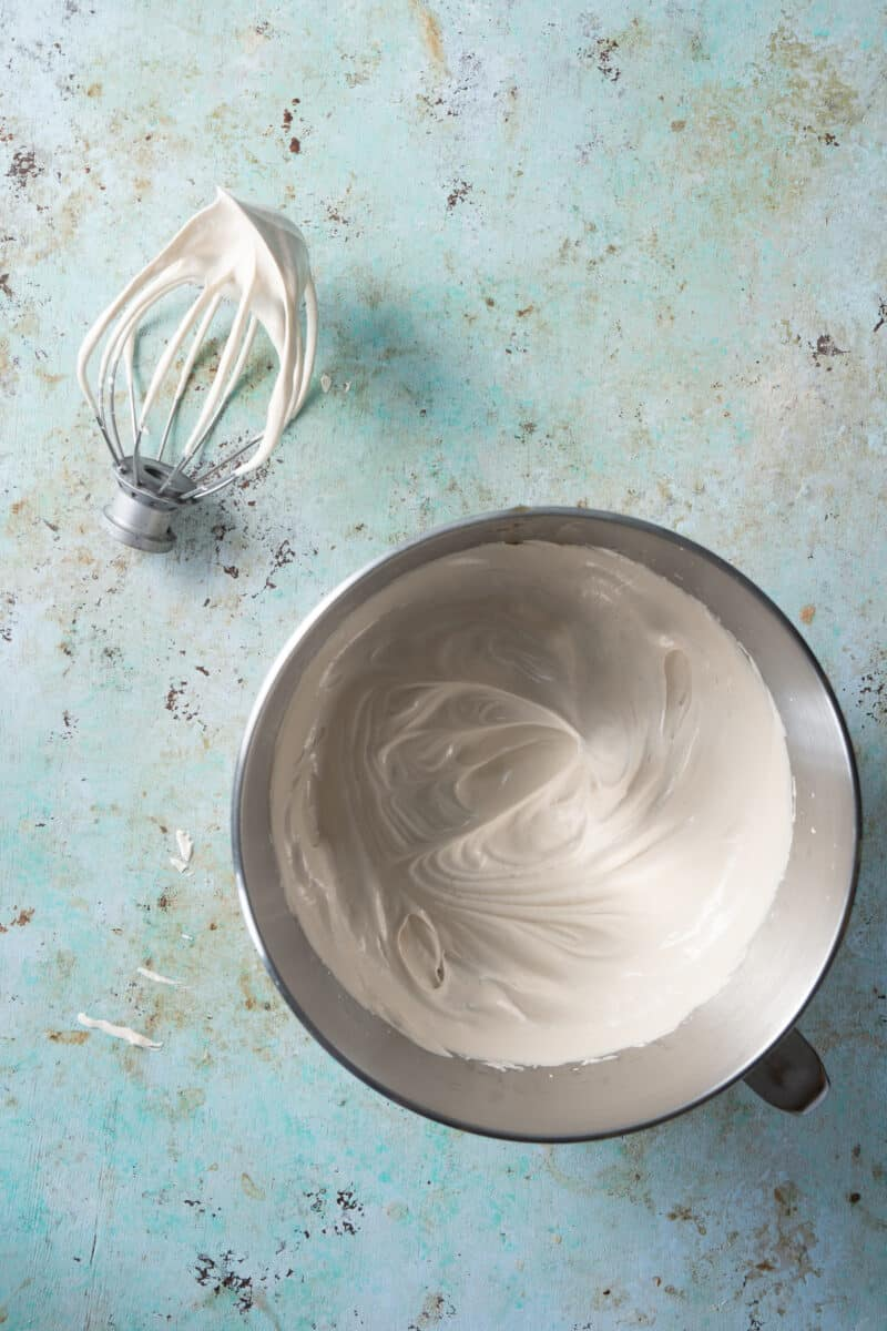 Italian Meringue whipped to medium peaks in the bowl of a stand mixer