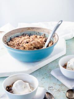 Apple crisp in a blue baking dish