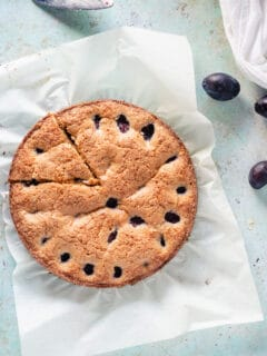 Almond anise plum torte with one slice cut