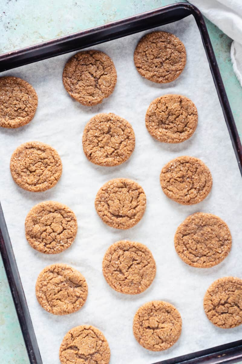 Chewy Citrus Molasses Spice Cookies on a sheet pan