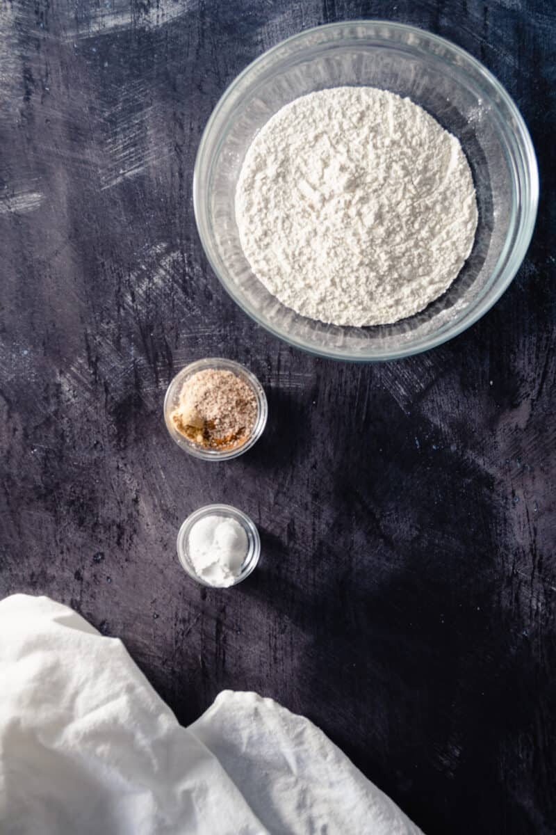 Flour, spices, baking powder and salt in mixing bowls