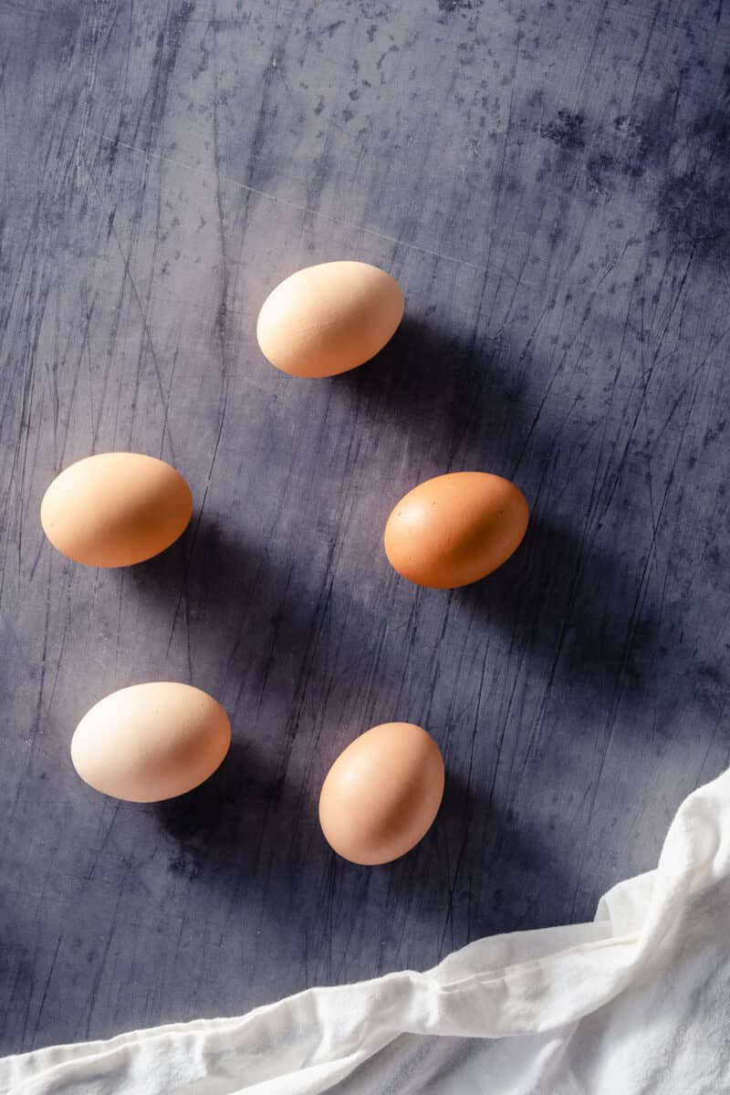 Five eggs on a counter