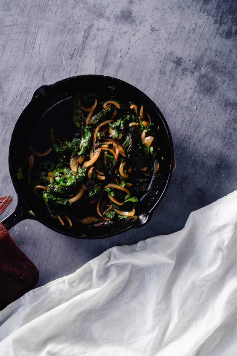 Chard and onions in a cast iron skillet