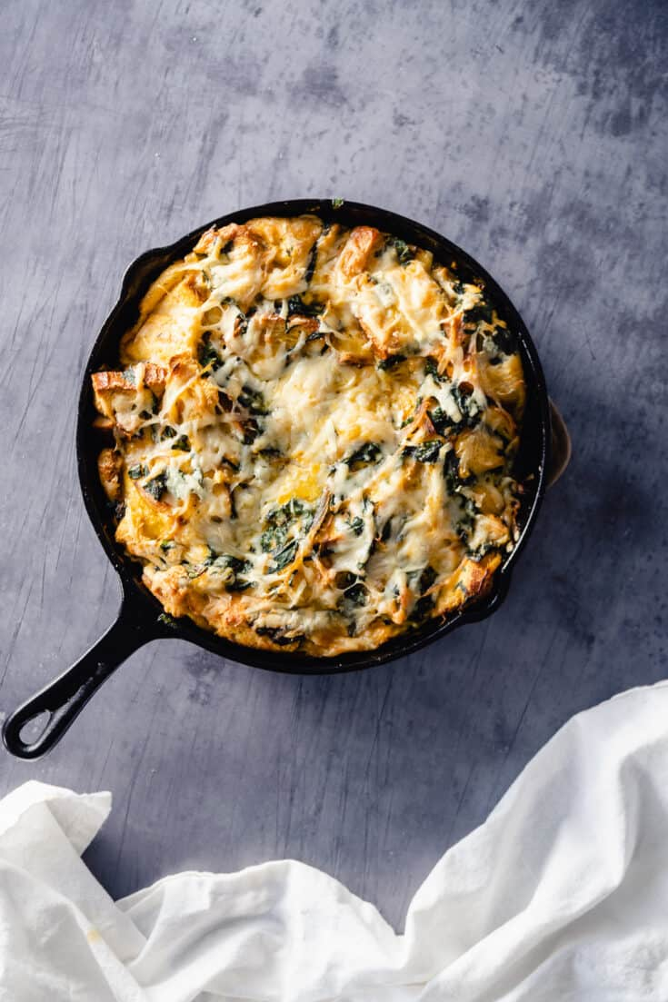 Swiss Chard and Gruyere Strata in a cast iron skillet