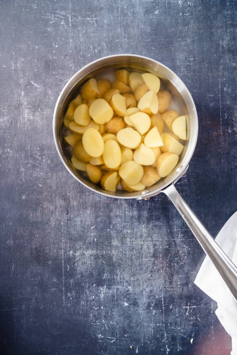 Sliced potatoes in salted water in a pot