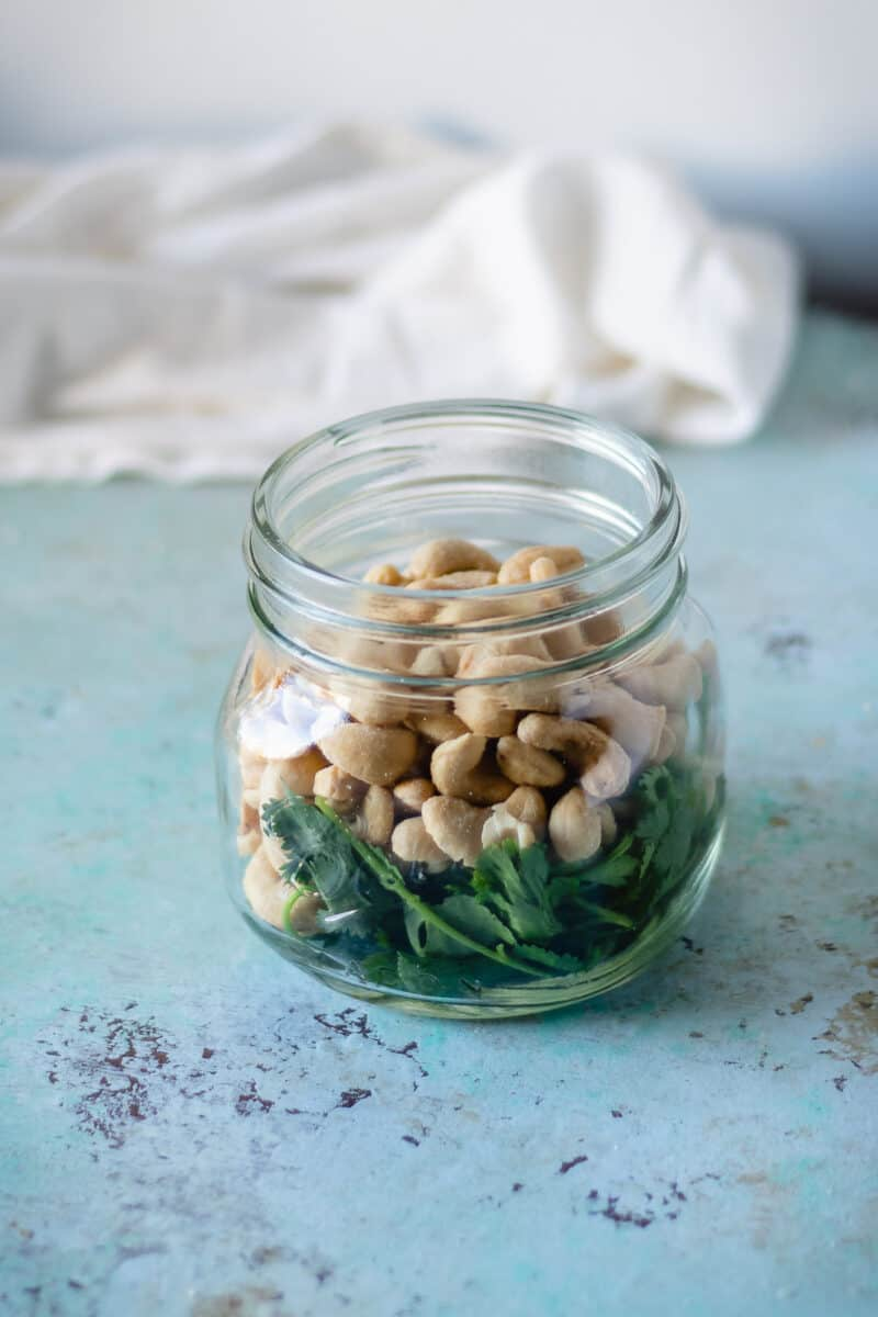 Jar with cilantro and peanuts