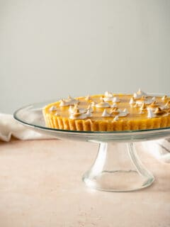 Lemon Ginger Tart on a glass cake stand