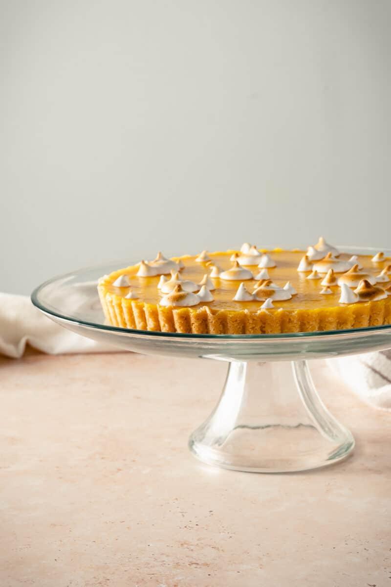 Lemon Ginger Tart on a glass cake stand